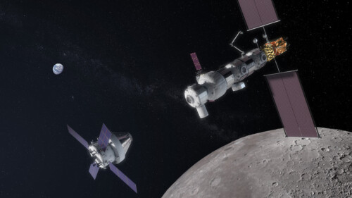 Gateway lunar orbiting station with Orion module approaching.