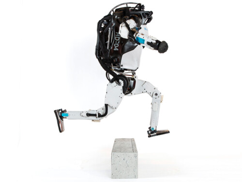 Boston Dynamics' Atlas jumping over an obstacle
